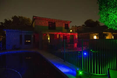 Green, Blue and Red Lasers illuminate home and yard.